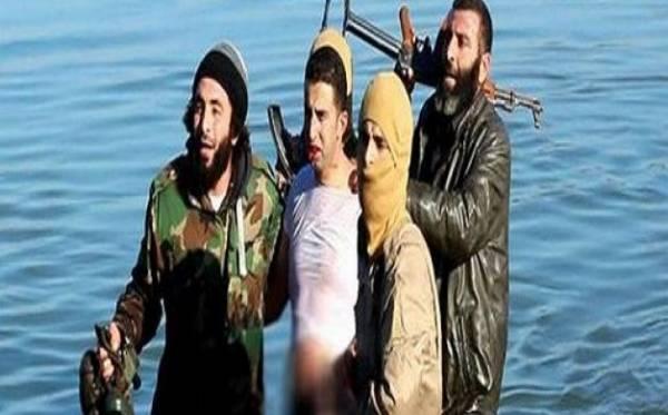 بالصور..داعش يسقط طائرة للتحالف الدولي ويقبض على الطيار