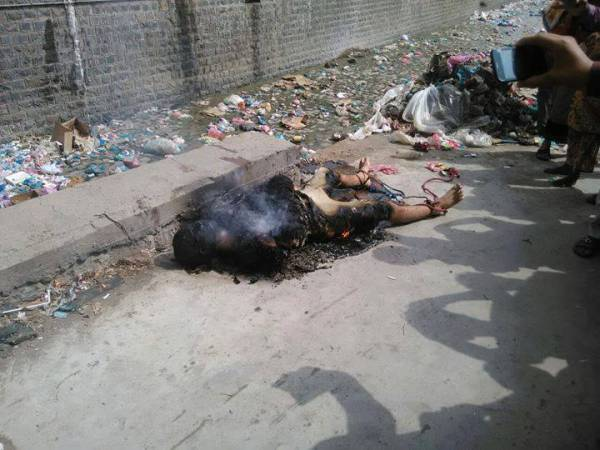 يحدث في اليمن.. أحرقوه حيا في تعز (صور +18)